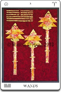 Dark red background with three yellow and orange wands